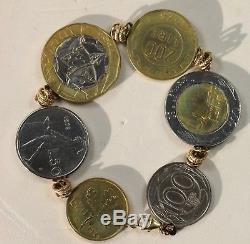 14kt gold Italian Italy Lire 6 Coin Bracelet 7.5 inches