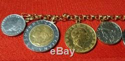 MARKED 14k 7.5 YELLOW GOLD CHARM BRACELET WITH 9 LIRE ITALIAN COINS